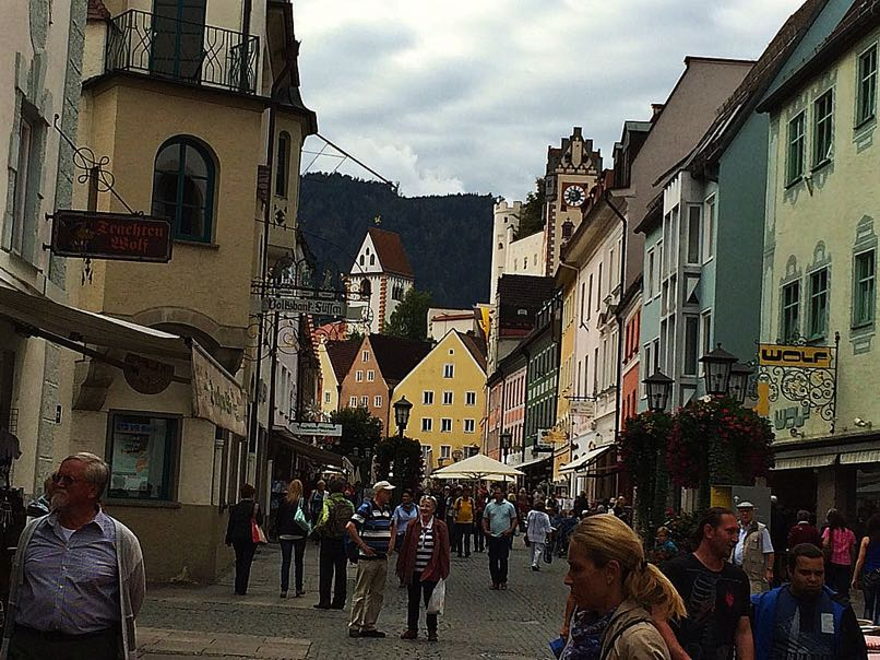Pedestrian-centre-with-the-towers-of-the-castle-and-monastery-rising-above-the-old-town-and-the-foothills-of-the-Alps-behind-them